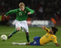 Damien Duff playing for Ireland against Brazil