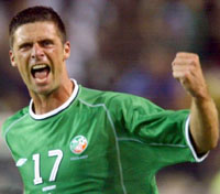Niall Quinn playing for Ireland
