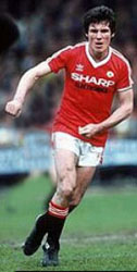 Frank Stapleton playing football  for Man Utd
