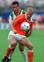 Paul McGrath and Dennis Bergkamp tussle for the ball at the 1994 World Cup