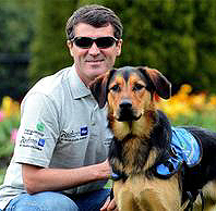 Roy Keane in 2012 with a guide dog