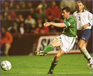 Roy Keane having a shot on goal for Ireland